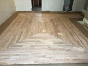 inlay floor installation, wood floor install, welborn floors, intricate wood inlay, hardwood installation